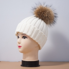 wool hat with raccon fur pompom