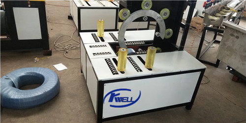 Horizontal type wrapping packing machine for soft flexible pipe coil