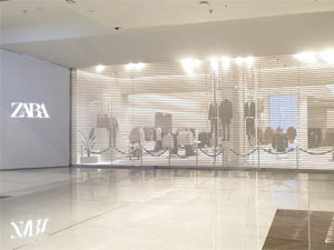 Large big size opening micro-perforated steel roller shutter doors project for ZARA shop in Dubai mall