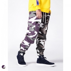 Boy stitching camouflage beamed overalls