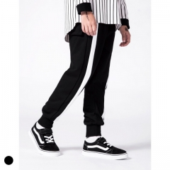 Boy color matching white striped sweatpants