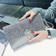 The new cross-body bag is simple and versatile temperament clutch bag female