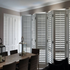 Grey wooden white louver plantation shutters for w...