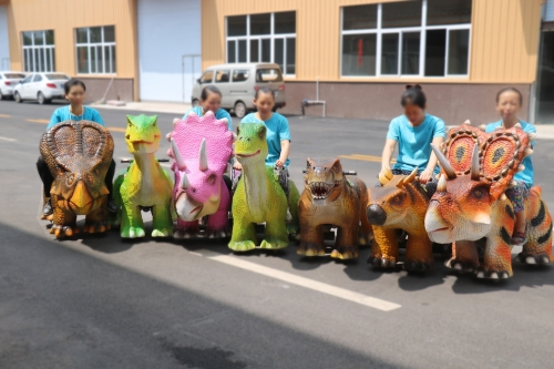 Playground equipment electronic dinosaurs to ride