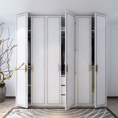 White painted casement closet with golden glazing