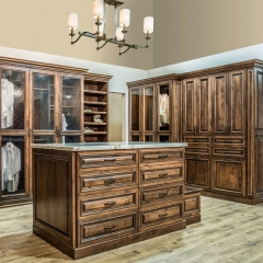 Dark stained cherry wood walk in wardrobe