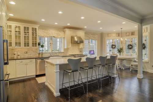 Provincial kitchen with white shaker door and mull...