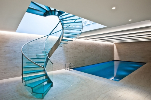 Single steel stringer curved staircase with glass ...