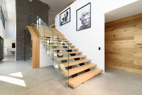 Double stringer staircase with standoff glass rail...