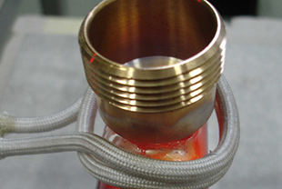 Composite brazing of metal materials such as brass, copper and stainless steel pot bottoms