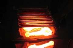 Heating and forging of railway parts