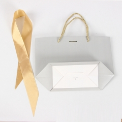 Wholesale Paper Luxury Bag with Ribbon Design Large Logo Pink Clothing Packaging Custom Gift Bags