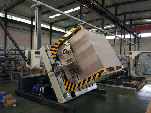 Pile turner machine for paper pile turning and pallet changing