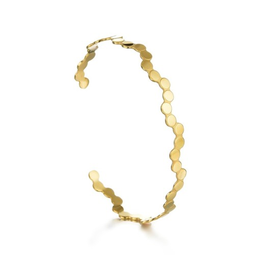 Dot wave cuff bracelet in gold plated stainless steel