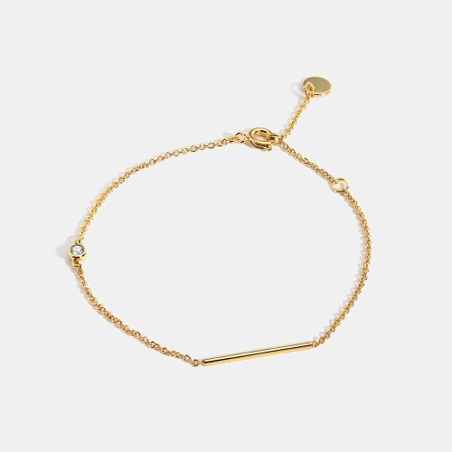 Wholesale Minimalist bracelet with bar and cubic zirconia bezel in 14k gold plating