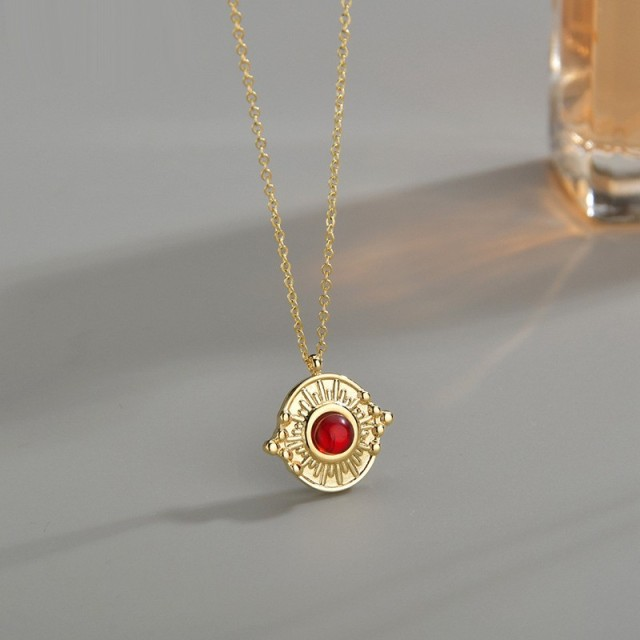 Vintage sunburst medallion with red agate necklace in steel