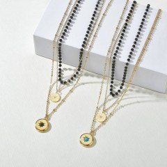 Starburst medallion bead chain triple layered necklace
