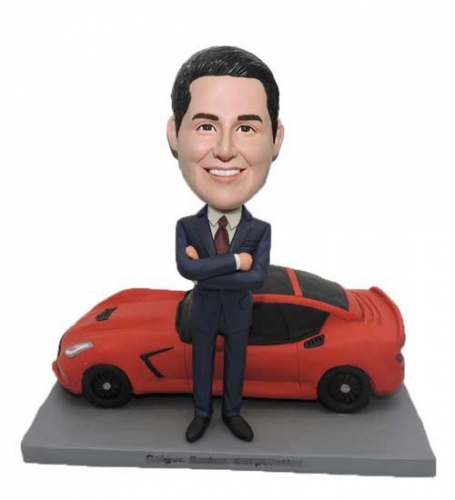 Man standing before his car bobblehead