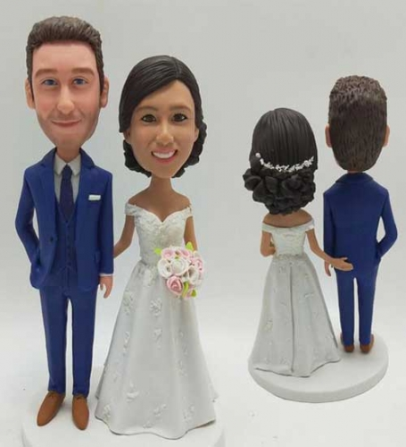 Custom bride and groom bobbleheads grabbing butts