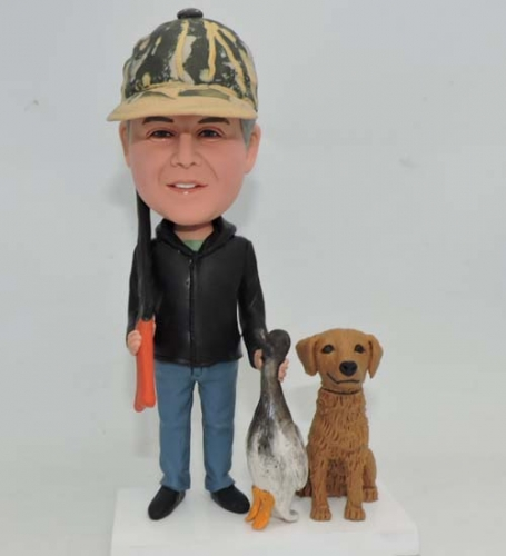 Custom bobblehead with his dog and gun