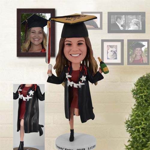 Happy Graduation Bobblehead with one leg heel raise and champagne